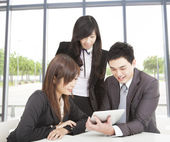 Business team working in the office and watching the tablet pc — Stock Photo