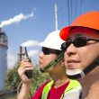 Close up of  two asian refinery workers — Foto Stock