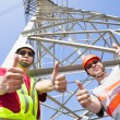 Two power line workers with thumbs up — Stock Photo