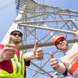 Two power line workers with thumbs up — Stock fotografie