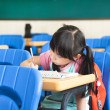 Stock Photo: School girl study alone in the classroom