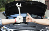 Hand of mechanic with thumbs up and tool — Stock Photo