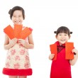 Happy chinese new year. smiling asian little girls holding red e — Stock Photo