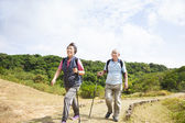Happy asian senior couple hiking — Stock Photo