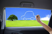 Hand drawing eco green car concept on the car windows — Stock Photo
