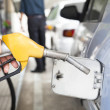 Gasoline pump refilling automobil fuel - Stock Photo