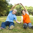 Happy Senior couple do physical training in the park — Stock Photo