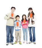 Happy chinese new year. happy chinese family holding red envelop — Stock Photo