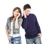 Happy asian couple talking on the phone — Stock Photo