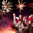 Happy asian family looking fireworks — Stock Photo #18910331