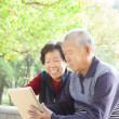 Happy asian Senior couple with tablet pc — Stock Photo