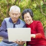 Happy asian Senior couple with laptop — Stock Photo