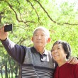 Senior couple taking picture of themselves outdoor — Stock Photo
