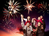 Happy asian family looking fireworks — Stock Photo