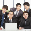 Stock Photo: Young business team working in the office