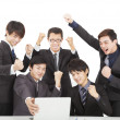 Happy young business team in the office — Stock Photo #19565027