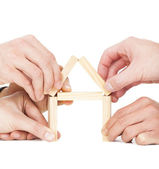 Five businessman's hand building house by wooden block — Stockfoto