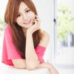 Smiling young beautiful asian woman — Stock Photo #19936273