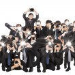 Foto Stock: Many photographers holding camerpointing to you and isolated o
