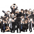 Many photographers holding camera pointing to you and isolated o — Stok fotoğraf