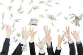 Many dollars falling on business hand — Stock Photo