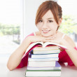 Stock Photo: Beautiful student girl with books