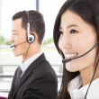 Smiling asian businessman with call center agent - Photo