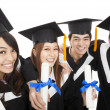 Stock Photo: Happy young graduate students group