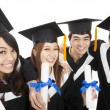 Happy young graduate students group — Stock Photo