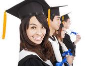 Estudiantes de postgrado felices y aisladas sobre fondo blanco — Foto de Stock