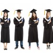 Full length of happy  young graduate students group — Stock Photo