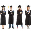 Full length of happy  young graduate students group — Stockfoto