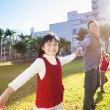 Happy  family in the school with sunlight background — ストック写真