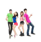 Young group of casual, smiling and dancing — Stock Photo