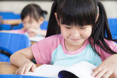 Happy little girls study in classroom — Stock Photo