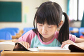 Little girl study alone in the classroom — Stock Photo