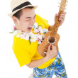 Stock Photo: Young man playing ukulele and singing