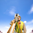 Surveyor engineer making measure on the field — Stock Photo