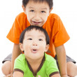 Happy little boy playing with his bother — Stock Photo