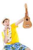 Happy man playing ukulele and singing — Stock Photo
