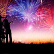 Stock Photo: Happy family standing on the hill and watching the fireworks