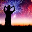 Father with child standing on the hill and watching the firework — Stock Photo #26904801