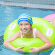 Beautiful little girls with inflatable ring at swimming pool — Stock Photo
