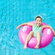 Happy little girl in the swimming pool — Stock Photo