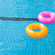 Colorful swimming pool rings on the water — Stock Photo