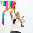 Happy family with colorful kite — Stock Photo