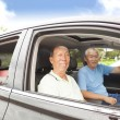Happy seniors enjoying road trip and travel — Stock Photo #29587159