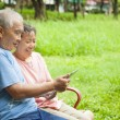 Happy asian seniors couple with tablet pc — Stock Photo