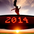 Happy new year 2014.runner jumping and crossing over matrix disp — Stock Photo