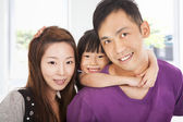 Happy family with little girl — Stock Photo